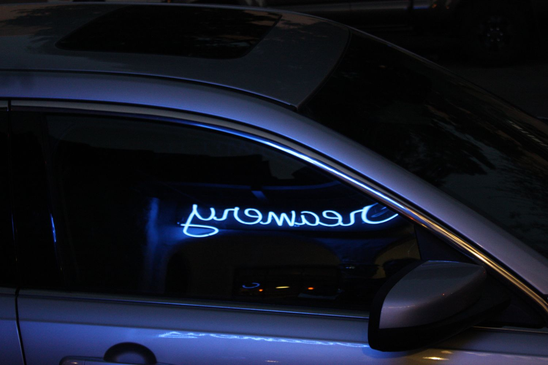 neon creamery reflection